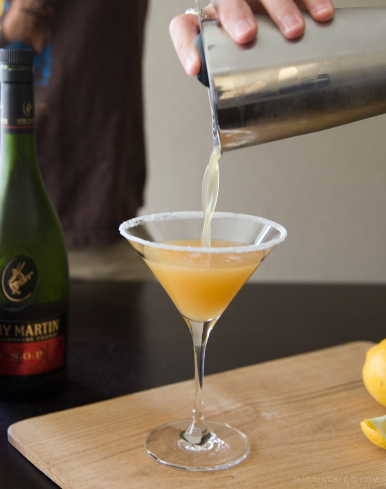 pouring sidecar cocktail