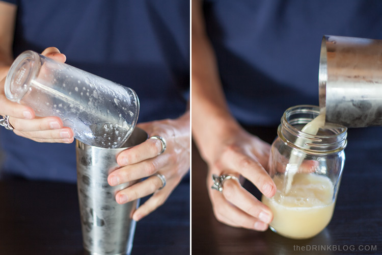 pour cocktail into mason jar