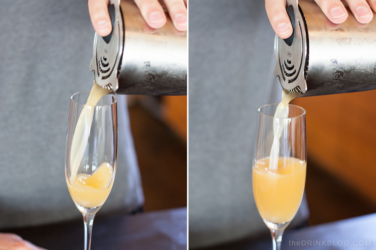 pour cocktail into champagne glass