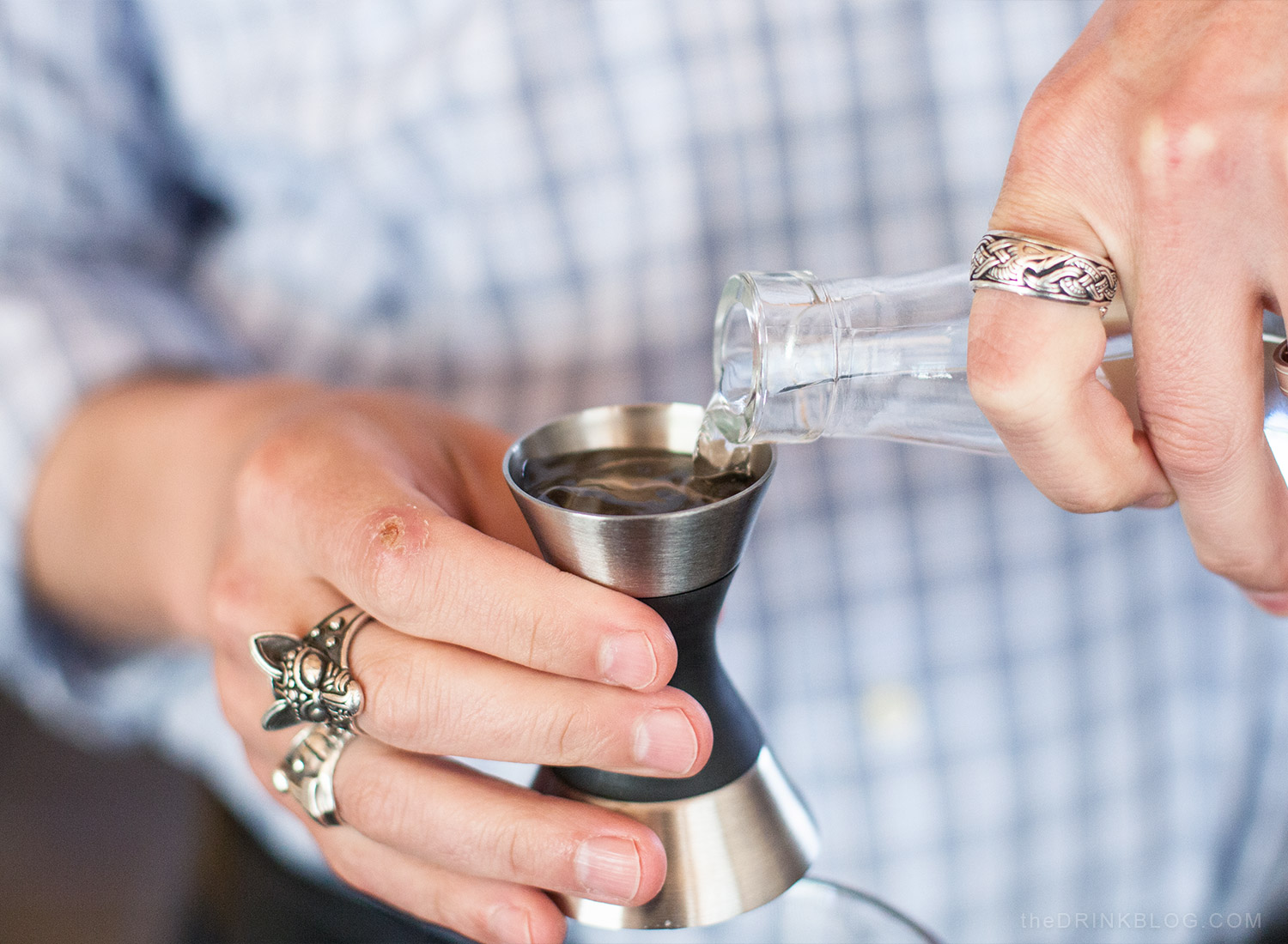measure rum with jigger